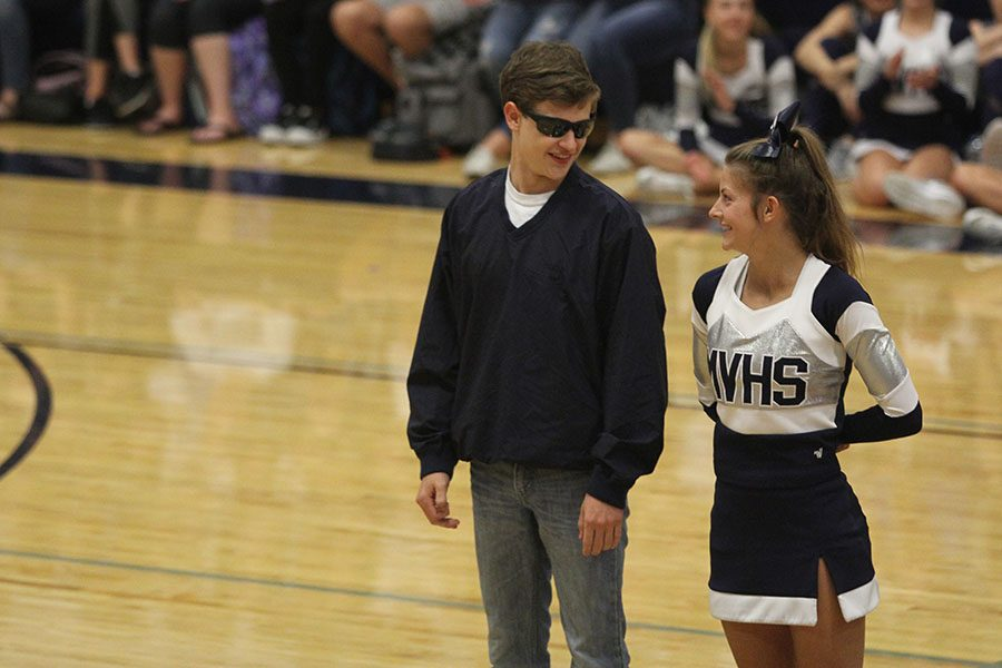 Homecoming king and queen candidates, seniors Noah Smith and Payton Totzke show off their Johnson County parent qualities.