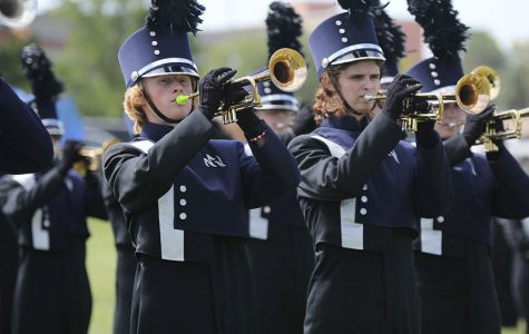 Before the Wednesday, Oct. 3 performance, junior Andrew Tow plays the trumpet in warm-up.