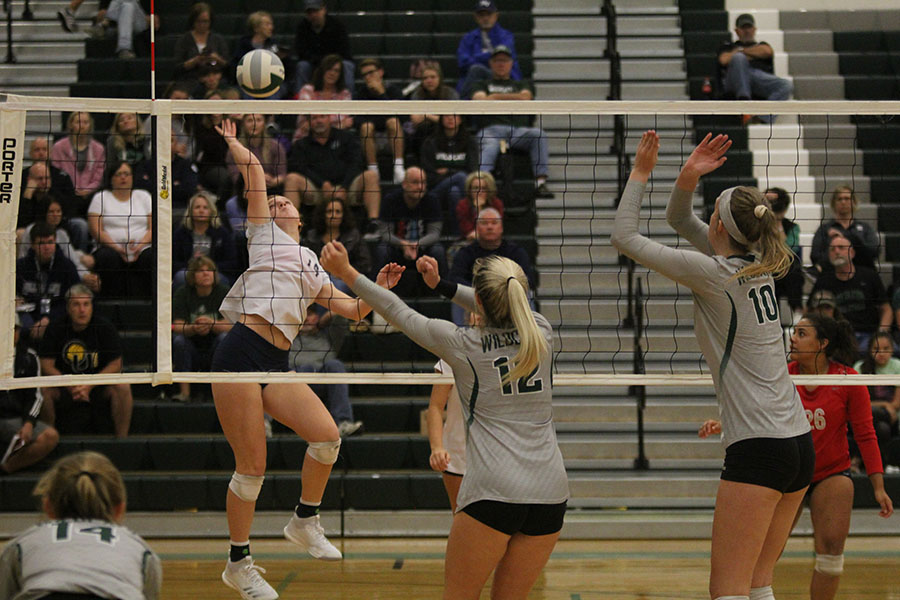 While+her+opponent%27s+brace+for+the+ball%2C+freshman+Brylee+Peterson+goes+leaps+in+the+air+to+hit.