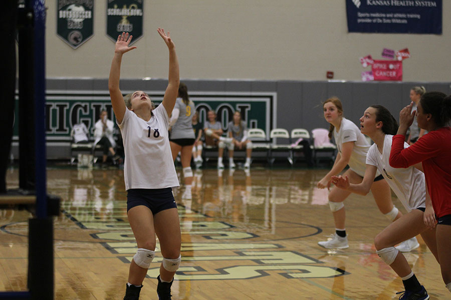 While+her+team+runs+to+help%2C+junior+Whitney+VanDyke+sets+the+ball+up+for+one+of+them+to+spike.