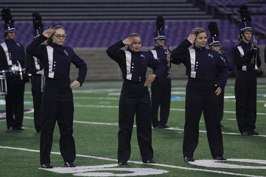 Saluting at the Central States Marching Show at Kansas State University on Saturday, Oct. 6, drum majors junior Amber Guilfoil, senior Marah Shulda and junior Kaleigh Johnston signal the band's readiness to begin.