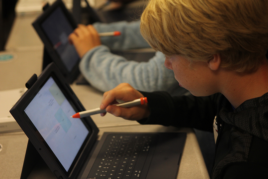 A freshman plays a game on an iPad to help him study on Thursday, Oct. 4 in Honors English I.