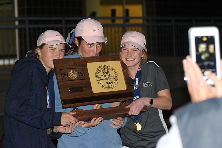 Sophomore Megan Haymaker, freshman Libby Green, and sophomore Ava Van Inwegen smile for pictures.