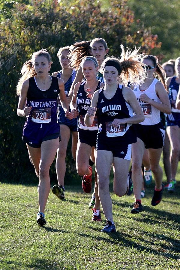 Right+at+the+start+of+the+race%2C+sophomore+Molly+Ricker+is+neck-and-neck+with+a+BVSW+opponent%2C+leading+the+pack+of+runners.+