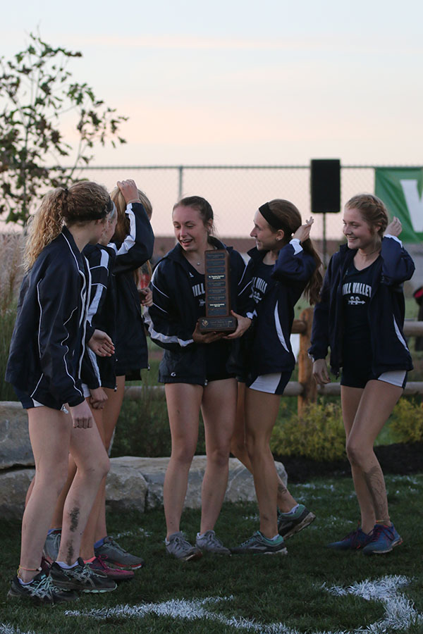 With+the+first+place+EKL+trophy+in+senior+Delaney+Kemp%27s+hands%2C+the+girls+cross+country+team+get+ready+to+pose+for+a+picture.