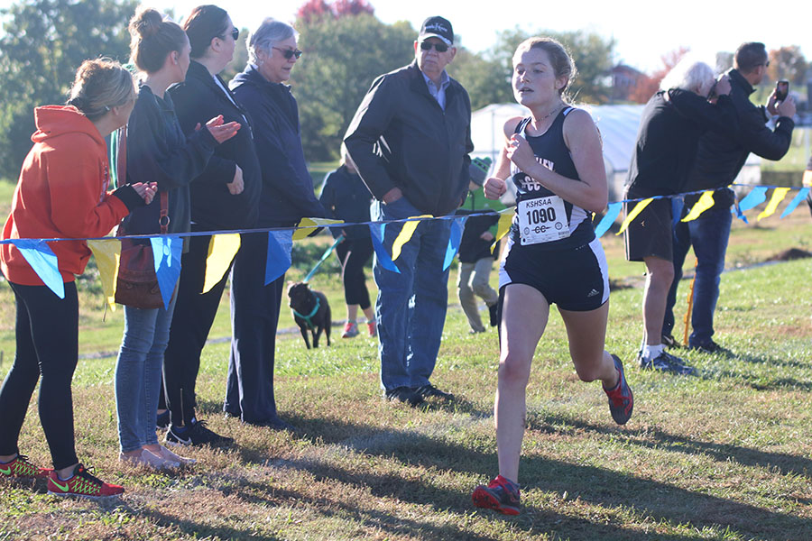 Reaching+the+finish+line%2C+junior+Jenna+Walker+prepares+to+stop.+Walker+placed+eleventh.
