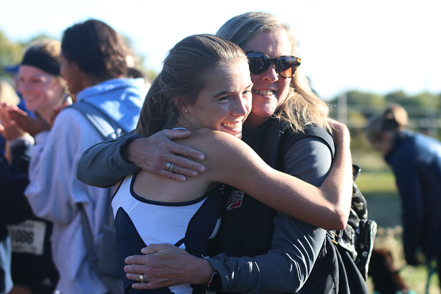 Engulfing+her+mom+in+a+hug%2C+junior+Molly+Haymaker+smiles+for+a+picture.+