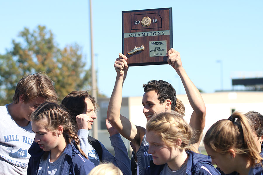 Holding+the+boys+6A+first+place+regional+plaque+up+in+the+air%2C+senior+Matt+Turner+smiles+at+junior+Darius+Hightower+at+Johnson+County+Community+College+on+Saturday%2C+Oct.+20.+