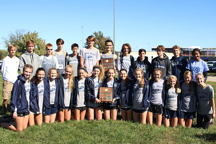 After+winning+the+6A+regional+meet%2C+the+boys+and+girls+cross+country+team+take+a+picture+together+with+the+plaques.+