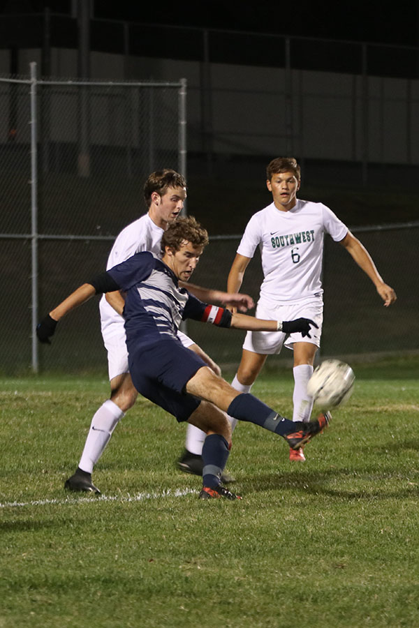 Sprinting+in+front+of+the+BVSW+player%2C+senior+Jake+Ashford+kicks+it+away+to+take+it+out+of+BVSW+possession.+