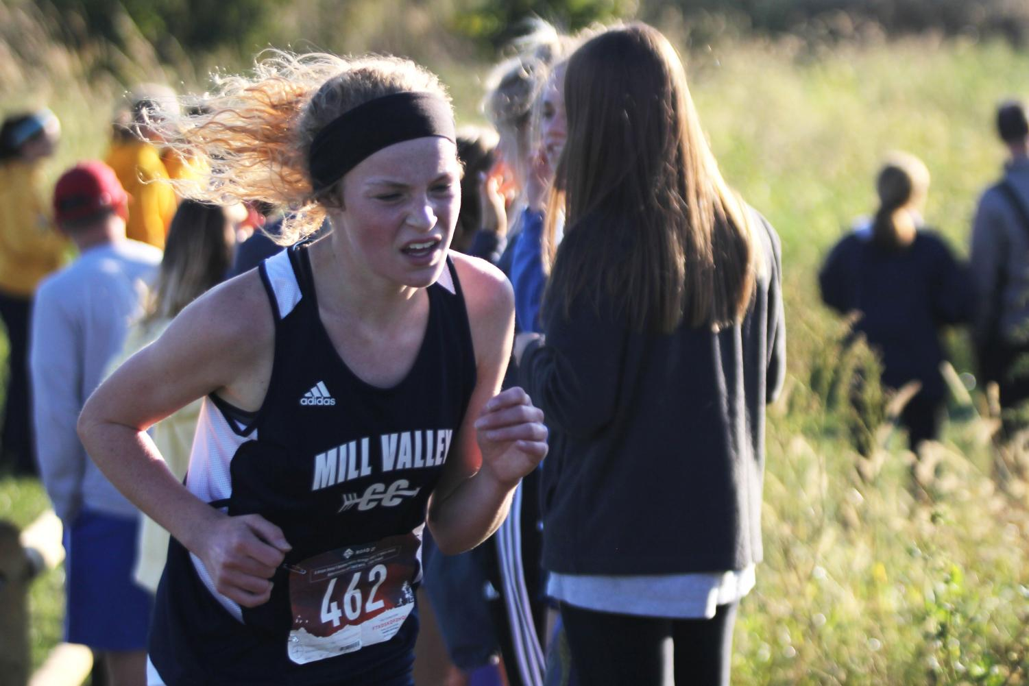 Running+uphill%2C+sophomore+Molly+Ricker+fights+to+maintain+her+speed.