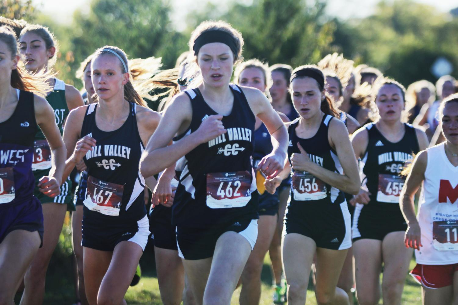 At+the+beginning+of+the+race%2C+sophomore+Molly+Ricker+runs+ahead+of+her+competitors+at+the+EKL+tournament+hosted+by+Blue+Valley+Southwest+on+Wednesday%2C+Oct.+10.+Girls+placed+first+place+and+boys+were+runner-up.