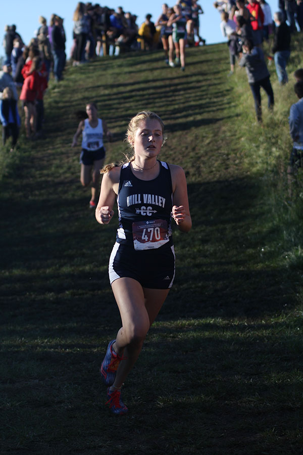 Beginning+her+second+lap%2C+junior+Jenna+Walker+reaches+the+bottom+of+the+courses+hill+on+Oct.+11th.