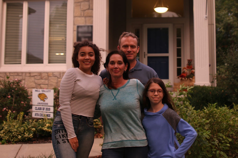 "With her host family, the Hanson's, senior foreign exchange student Gabriella Silva Moura stands in front of their house on Tuesday, Sept. 25. ""It was always my dream to go to another country to know another culture and language,"" said Silva Moura. ""So I chose the United States."""
