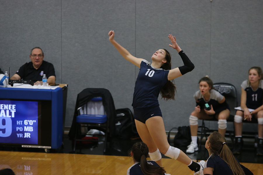 Eyeing+the+ball+carefully%2C+sophomore+Molly+Carr+gets+ready+to+spike+the+ball.