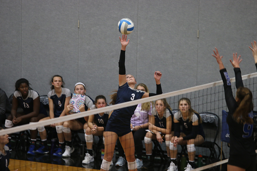 Reaching+her+arm+out%2C+sophomore+Jaden+Ravnsborg+hits+the+ball+over+the+net.