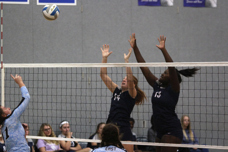 While+jumping+in+the+air%2C+freshmen+Taylor+Roberts+and+Brylee+Peterson+block+their+opponent+hit.