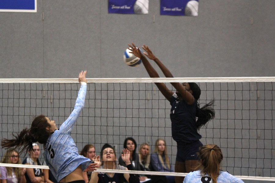 With+her+hands+over+the+net%2C+junior+Faith+Archibong+narrowly+misses+a+block.