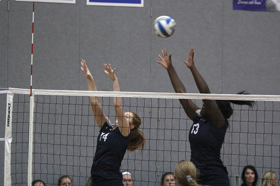 With+their+hands+outstretched%2C+freshmen+Taylor+Roberts+and+Brylee+Peterson+attempt+to+block+the+ball.