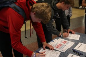 Seniors Hunter Harris and Steven Colling stand side by side as they register to vote.