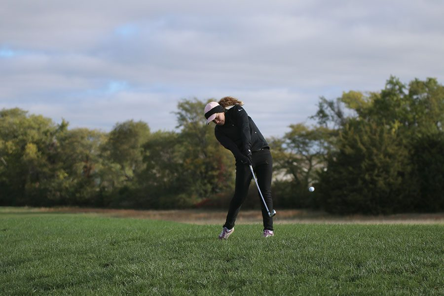 On Thursday, Oct. 11, junior Hannah Davie chips the ball onto the green at the 6A Gardner Edgerton regional tournament.