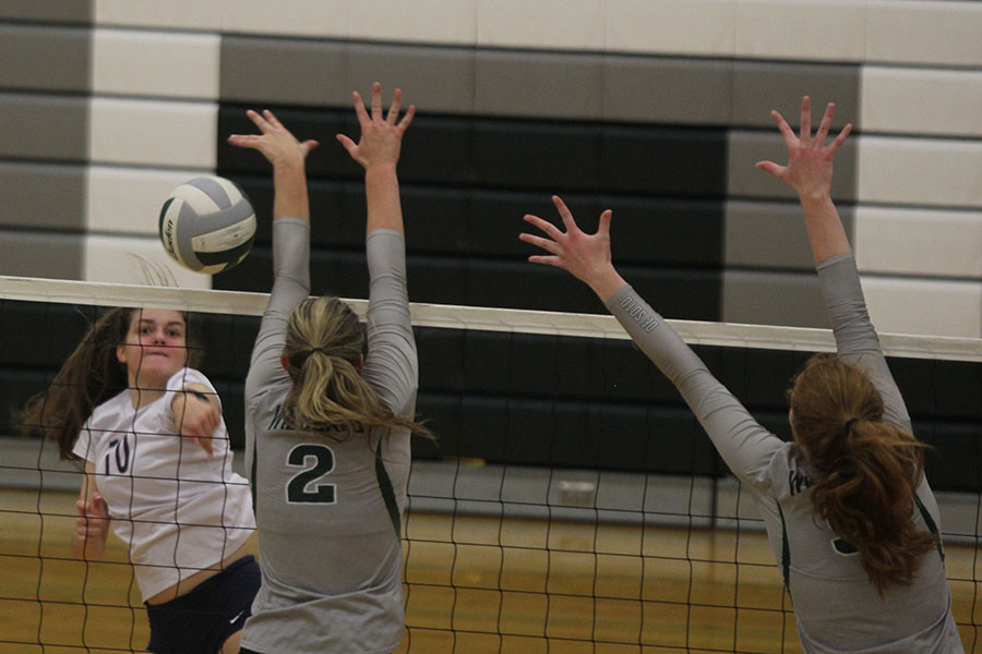 With+her+opponent+attempting+a+block%2C+sophomore+Molly+Carr+hits+the+ball+past+them.