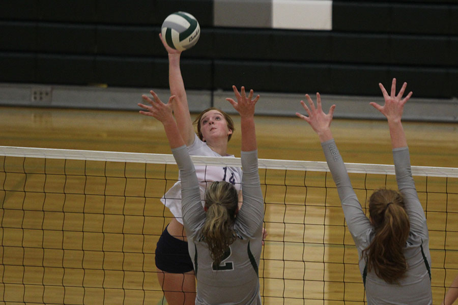 With+her+opponent+attempting+a+block%2C+freshman+Brylee+Peterson+hits+the+ball.
