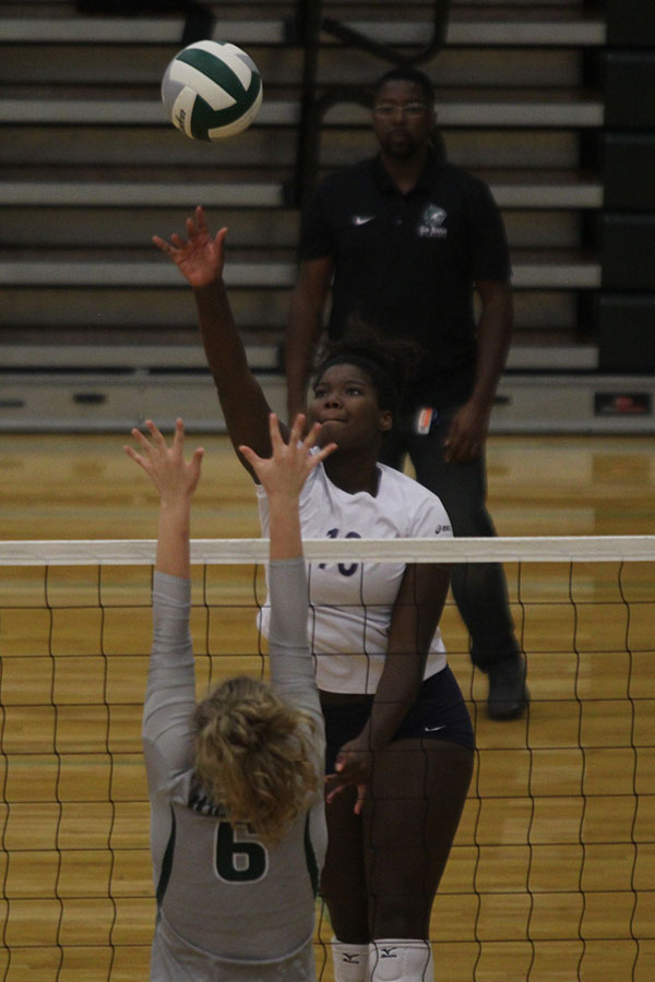 With+her+opponent+attempting+a+block%2C+freshman+Taylor+Roberts+hits+the+ball.