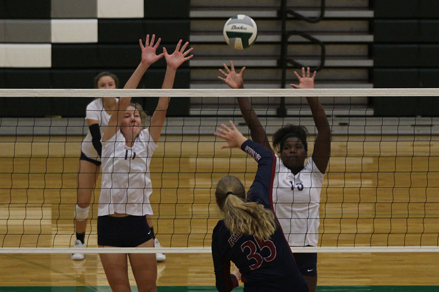As+their+opponent+hits+the+ball%2C+freshmen+Kate+Roth+and+Taylor+Roberts+attempt+a+block.