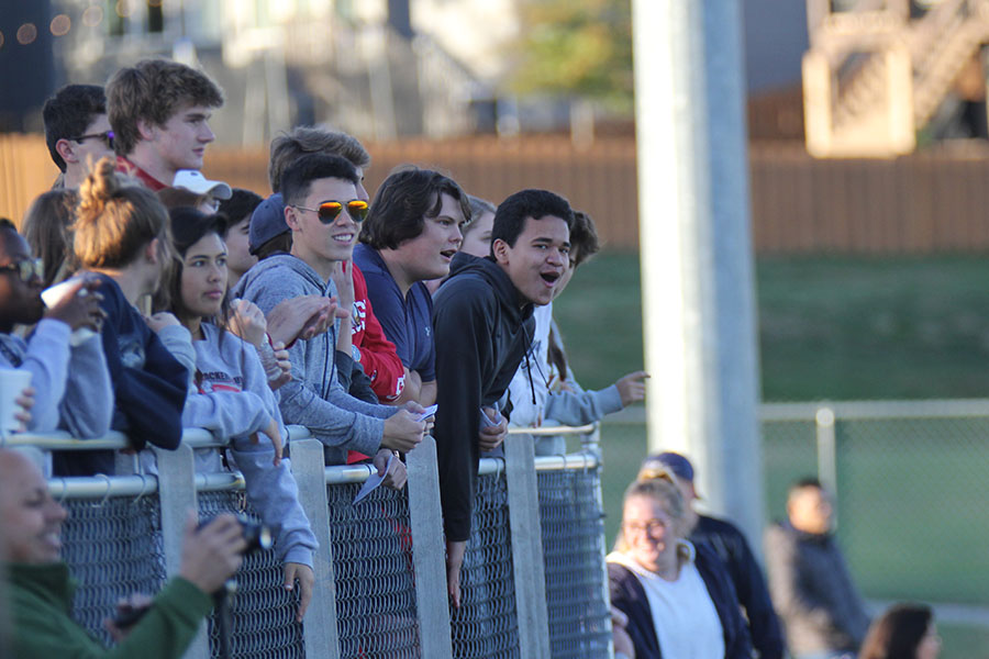 Cheering+on+the+boys+soccer+team%2C+junior+Jacob+Contreras+bangs+on+the+bleachers+and+shouts+at+the+opposing+team.%0A
