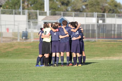 "Before the game, the boys soccer team huddles up for a pep talk. ""It's the post season, so [losing] is always at the back of our minds and they scored two,"" senior team captain Jake Ashford said. ""Especially at the second part of the second half, it was close."""