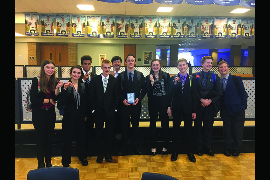 After learning the results of the two-day long tournament, the debate team proudly shows off their awards on Saturday, Oct. 13.