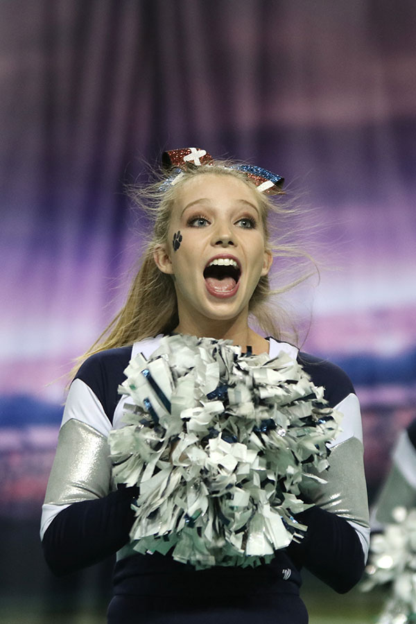 Showing+her+spirit%2C+senior+Kate+Backes+screams+during+the+crowd+leading+routine.
