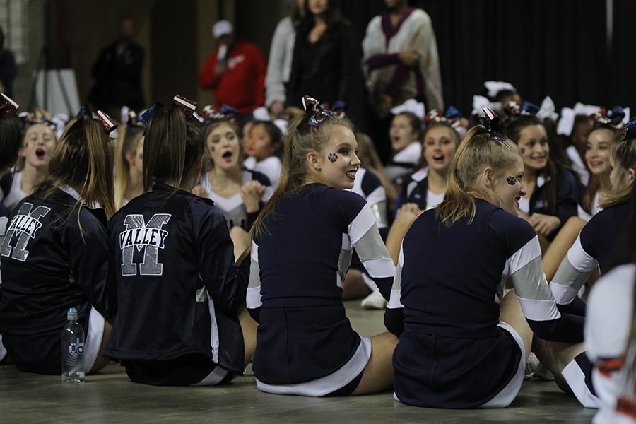 Awaiting her results, senior Kate Backes looks to the judges' table as she sits with her teammates on the floor of the Expocentre.
