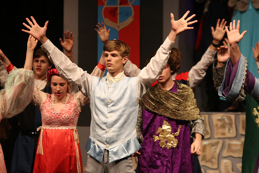 Shaking+his+hands+in+the+air%2C+sophomore+Leif+Campbell+looks+up+during+a+dancing+scene.+