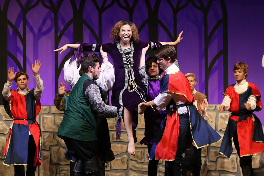 As Winifred, played by senior Lucy Graff,  is introduced, she is lifted up in the air as she sings during dress rehearsal for Once Upon A Mattress on Tuesday, Nov. 2.