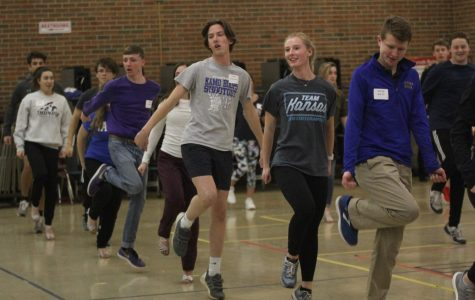 "On Wednesday, Nov. 28, senior Ally Klaudt dances alongside the other participants at Cotillion practice held at Bishop Miege. ""The dances were fun, which helped me be engaged while learning,"" Klaudt said. ""The steps weren't too difficult and I found myself wanting to practice them."""