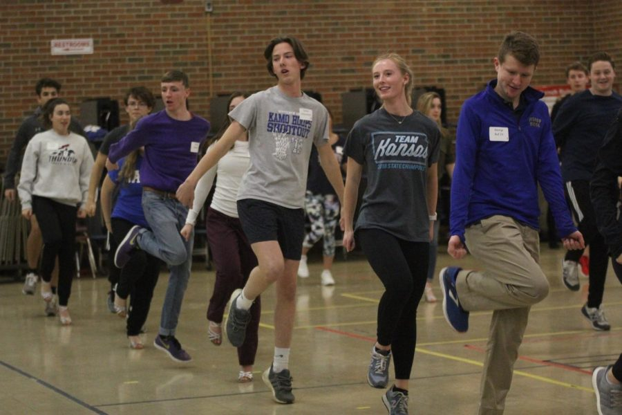 """On Wednesday, Nov. 28, senior Ally Klaudt dances alongside the other participants at Cotillion practice held at Bishop Miege. """"The dances were fun, which helped me be engaged while learning,"""" Klaudt said. """"The steps weren't too difficult and I found myself wanting to practice them."""""""