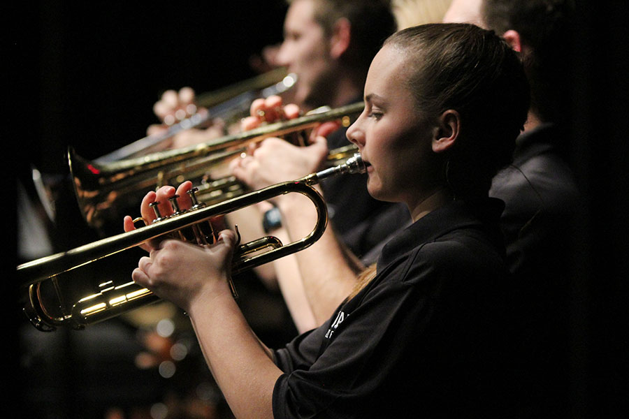 In the back line of trumpeters, freshman Katelyn Kurovski keeps her eyes on the sheet music and her trumpet held up straight.