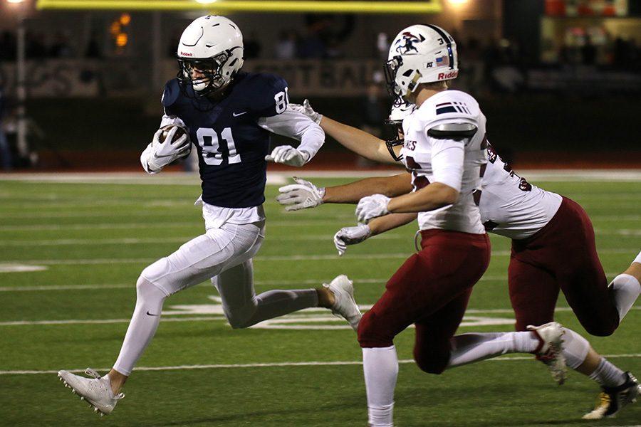 Running toward the sideline, senior wide receiver Grant Rachwal nearly misses SJA defenders.