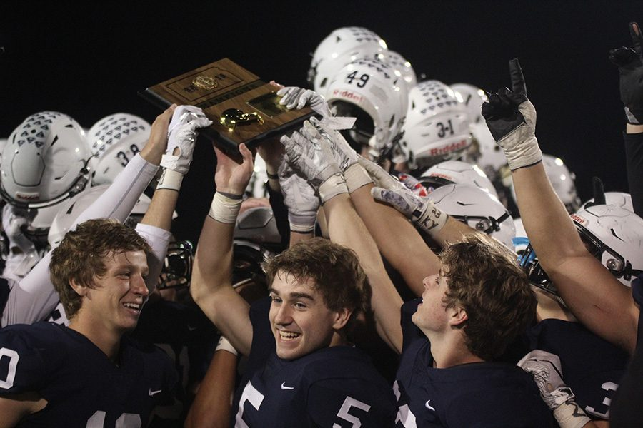 Smiling+alongside+teammates%2C+senior+wide+receiver+Logan+Talley+celebrates+the+team+winning+the+regional+title.+The+Jaguars+defeated+St.+James+24-7+on+Friday%2C+Nov.+2.+