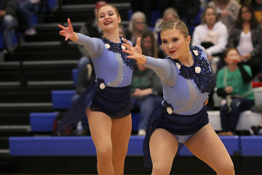 Reaching+out%2C+sophomore+Jenna+Haase+performs+in+the+lyrical+jazz+routine+at+the+Kansas+City+Classic+on+Saturday%2C+Dec.+8.+At+the+Kansas+City+Classic%2C+the+team+finished+first+in+Division+3+pom+and+lyrical+jazz%2C+senior+Olivia+Augustine+placed+first+in+senior+solos%2C+senior+Addie+Ward+placed+seventh+in+senior+solos+and+junior+Sydney+Ebner+placed+tenth+in+junior+solos.
