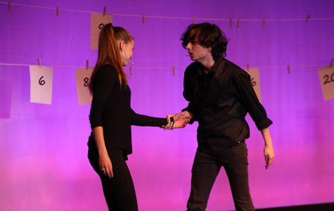 "In a break up scene, junior Aidan Thomas tries to convince with the other character, played by senior Annika Lehan, to stay in a relationship with him.  ""People are able to do funky things that they don't get to do before and get out of their comfort zone"", Thomas said after the show on Thursday, Dec 6."