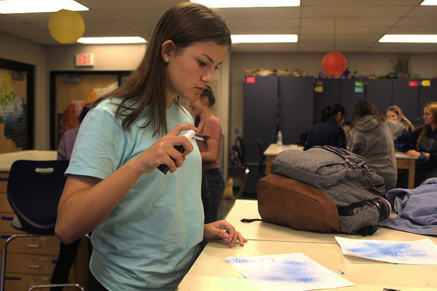 At the National Art Honor Society meeting on Nov. 8, freshman Mallory Lewis sprays water on her project.
