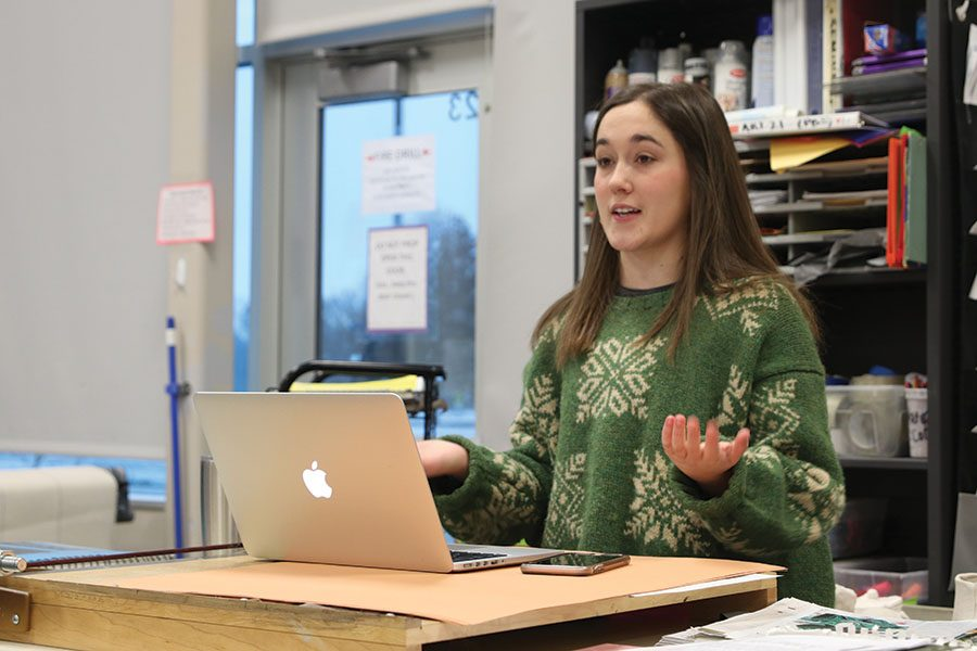 """Looking out towards different StuCo members, senior student body president Hannah Barnes explains what is going on at their meeting on Thursday, Nov. 29. """"I decided it would be a [good] way to get involved in high school,"""" said Barnes """"Little did I know that it would be the best decision I've made in all of high school."""""""
