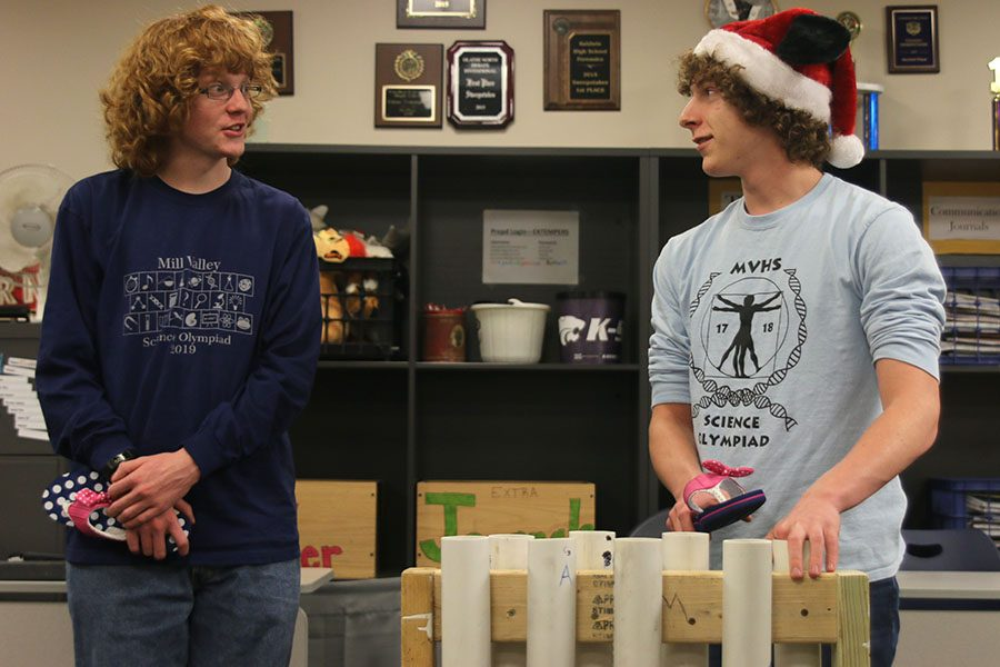 Turning to partner junior Griffin Schenk, junior Logan Oesterreich prepares to hit a PVC pipe with a flip flop to create a sound for the Sounds of Music event.
