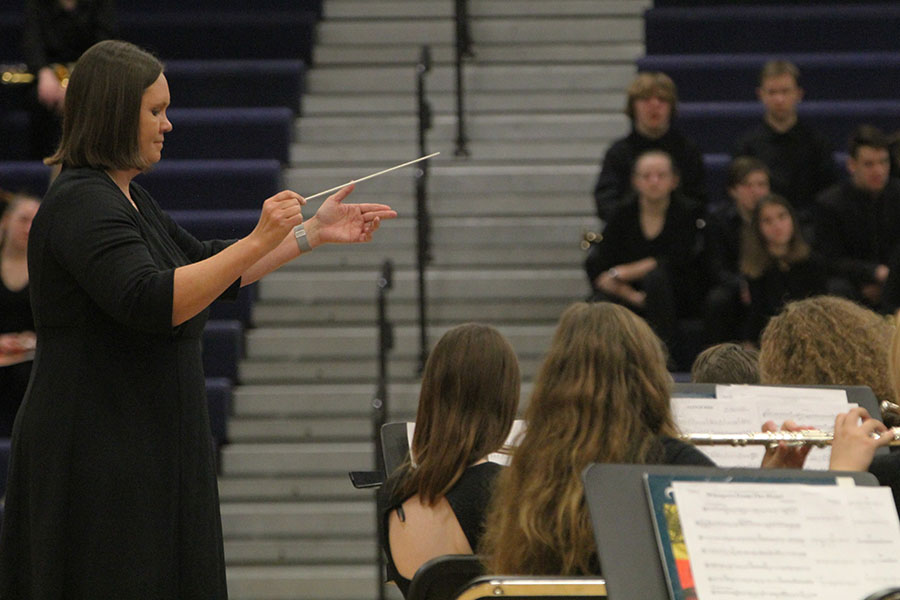 Band director Debra Steiner conducts the band as they perform for the crowd.