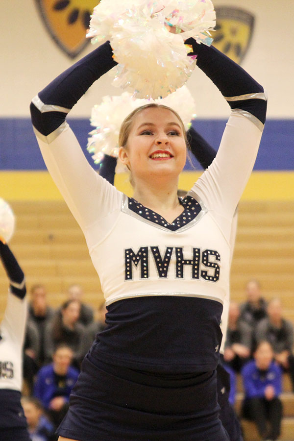Poms+above+head%2C+junior+Sydney+Ebner+dances+in+the+pom+routine%2C+which+received+the+Polish+and+Precision+award+at+Miss+Kansas+on+Monday%2C+Jan.+21.