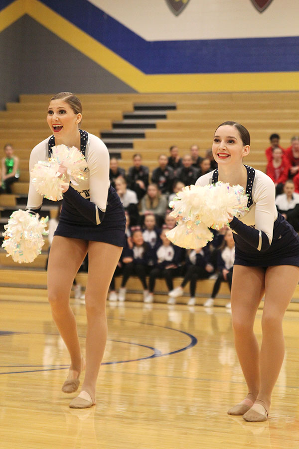 Shaking+their+poms+together%2C+senior+Addie+Ward+and+sophomore+Lauren+Acree+perform+in+the+pom+routine%2C+which+received+the+Polish+and+Precision+award+at+Miss+Kansas+on+Monday%2C+Jan.+21.