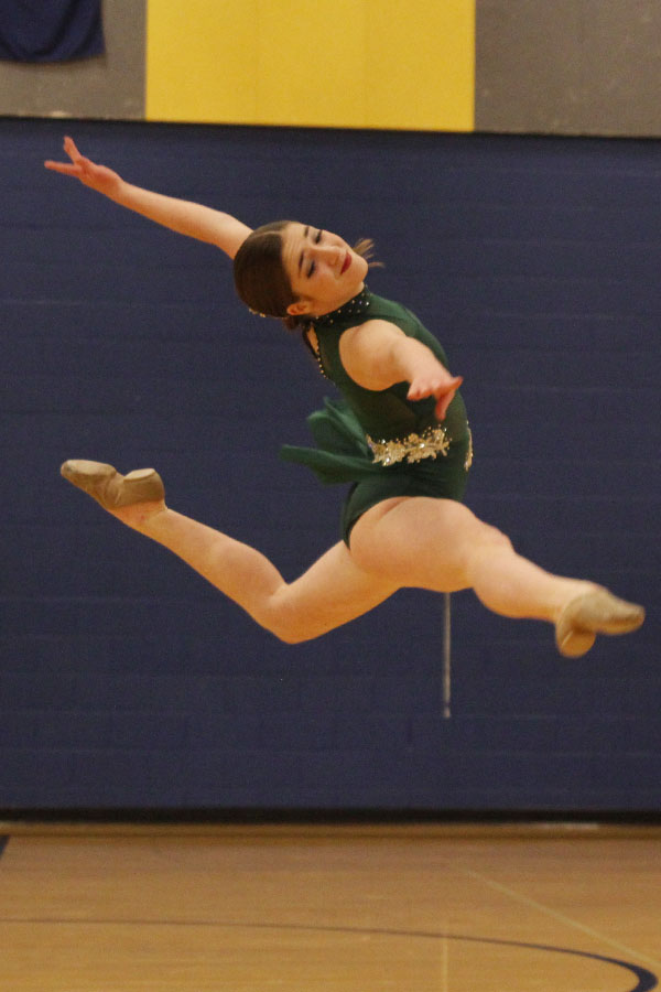 Leaping+into+the+air+during+her+solo%2C+freshman+Anna+Brazil+matches+her+facial+expression+to+the+music.+